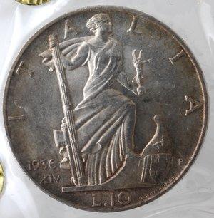 reverse: Casa Savoia. Vittorio Emanuele III. 1900-1943.10 lire 1936 Impero. Ag. Gig. 64. Periziata FDC da Giacomo Valente. Colpetto al ciglio. Patina Iridescente.