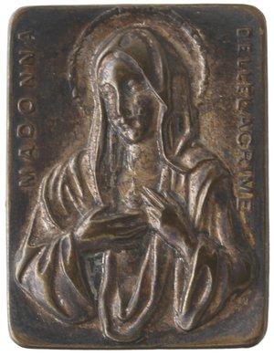 obverse: Medaglie. Siracusa. Placchetta devozionale. Madonna delle Lacrime. Ag. Sec. XIX. Diametro mm. 24x18. qFDC. Patina e ottima conservazione.