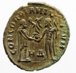 R/ Impero Romano. Diocleziano. 284-305 d.C. Antoniniano, Heraclea. AE. D/ Busto radiato e drappeggiato a destra. R/ CONCORDIA MILITVM Diocleziano, stante a destra, riceve da Jupiter Vittoria su globo, che lo incorona. Nel campo, in basso, HB. RIC 13. Peso gr. 3,40. SPL.Patina Marrone