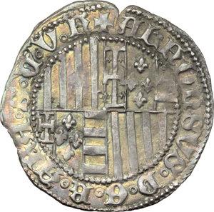 D/ Napoli. Alfonso I d'Aragona (1442-1458). Carlino con sigla S (Francesco Senier Maestro di Zecca 1450-1455).    P/R 3e. MIR 54/6. AG. g. 3.55    Lo scudo ha quattro gigli. La palatura del 2° quadrante ha due fasce. Patina dorata qSPL.
