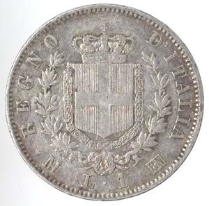R/ Casa Savoia. Vittorio Emanuele II. 1861-1878. Lira 1863 Milano. Ag. Gig. 64. qSPL. Patina da monetiere.