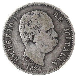 D/ Casa Savoia. Umberto I. 1878-1900. Lira 1884. Ag. Gig 36. qBB. NC.