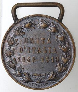 R/ Medaglie. Vittorio Emanuele III. 1900-1943. Per il 70° dell'unità d'Italia. Ae. Diametro mm. 31,50. La medaglia a ricordo dell'Unità d'Italia 1848-1918 fu istituita il 19 gennaio 1922 e conferita a tutti coloro i quali è stata concessa la medaglia commemorativa della guerra Italo-Austriaca. qSPL.