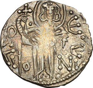 D/ The Empire of Trebizond. Manuel I Comnenus (1238-1263). AR Asper with St. Eugenius and the Emperor.  D/ The Emperor standing facing holding a processional cross. R/ St. Eugenius standing facing holding a processional cross. Retowsky 11. Bendall 20. AR. g. 2.28  mm. 21.00   Variety with floreal fantasy at the reverse. About EF.