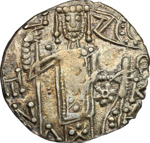 R/ The Empire of Trebizond. Manuel I Comnenus (1238-1263). AR Asper with St. Eugenius and the Emperor.  D/ The Emperor standing facing holding a processional cross. R/ St. Eugenius standing facing holding a processional cross. Retowsky 11. Bendall 20. AR. g. 2.28  mm. 21.00   Variety with floreal fantasy at the reverse. About EF.