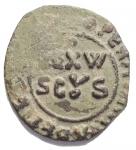 D/ Zecche Italiane. Messina. Guglielmo II(1166-1189). AE. Mezzo Follaro (15,4 x 17 mm. 1,42 g). d/REX W SCUS. R/ Legenda cufica. Spahr 119. BB+