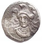 D/ Mondo Greco - Cilicia. Tarsos. Balakros, satrapo di Cilicia. 333-323 ac. Statere Ag. 22,3 mm. 10,23 g. d/ Baaltars seduto a sinistra con in mano uno scettro con la punta di loto; a sinistra orecchio di grano e grappolo d'uva; a destra B; sotto il trono, M. r/ Busto drappeggiato di Athena rivolto leggermente a sinistra con elmo attico crestato. qBB. Raro. ex Rauch