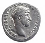 obverse: Impero Romano. Adriano. 117-138 d.C. Denario. Ag. Roma. D\ IMP CAESAR TRAIA - N HADRIANVS AVG, Busto laureato a destra. R\ P M T - R P - COS III, Roma seduta verso sinistra su di una corazza, tiene Vittoria e lancia; dietro, uno scudo. RIC 77; C 1103. Peso 2,60 gr. Diametro 19,00 mm. BB.**