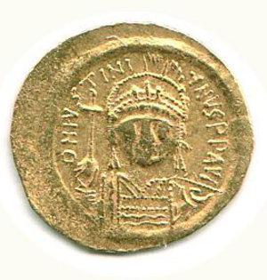 R/ GIUSTINIANO I (527-565) - Solido; D/ Busto elmato e corazzato di fronte; R/ Vittoria stante con croce e globo crucigero - Peso g. 4,5 - Ratto 444. - - AU - q.BB