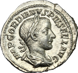 D/ Gordian III (238-244 ). AR Denarius, 241-243.  D/ Bust right, laureate, draped, cuirassed. R/ Apollo seated left, holding branch and resting elbow on lyre. RIC 114. AR. g. 2.83  mm. 21.00    About EF.