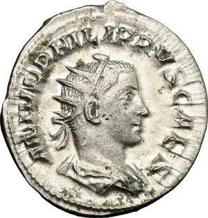 D/ Philip II (244-249). AR Antoninianus, 244-246.  D/ Bust of Philip II right, radiate, draped, cuirassed. R/ Philip II standing left, holding globe and reversed spear. RIC 218d. AR. g. 3.76  mm. 23.00    Good VF.