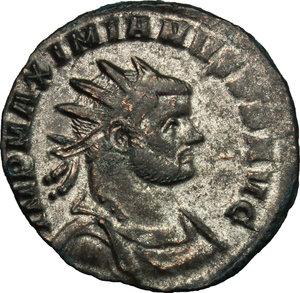 D/ Maximian (286-310). BI Antoninianus, 285-286.  D/ Bust right, radiate, draped, cuirassed. R/ Jupiter standing left, cloak hanging from left shoulder, holding thunderbolt and scepter. RIC V, 506. BI. g. 3.27  mm. 21.00   Heavily toned. VF.