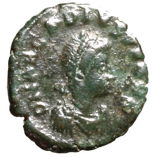 D/ Arcadius (383-408). Antiochia. AE4. D N ARCADIVS P F AVG, pearl diademed, draped, and cuirassed bust r. R/ VOT/ X/ MVLT/ XX in four lines within wreath; ANTΓ in exergue. RIC 56d AE g- 1, 19. about EF