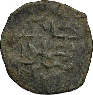 R/ Qrim. Orda d'oro. Ozbeg Khan (AH 713-740/1313-1339 d.C). Follaro, ca. 725 AH.    Lebedev. cfr. M48a. A. 2026. AE. g. 1.73  mm. 22.00   Patina verde.  BB.