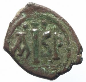 reverse: Bizantini. Giustiniano. 527-565 d.C. 16 Nummi. Æ. Tessalonica. D\ Busto verso destra. R/ Grande AISP, sotto TES. S.179. Peso 6,60 gr. Diametro 23,00 mm. qBB.