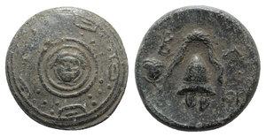 obverse: Kings of Macedon, Philip III Arrhidaios (323-317 BC). Æ Half Unit (15mm, 4.29g, 12h). Miletos or Mylasa, c. 320 BC. Macedonian shield, with facing gorgoneion on boss. R/ Crested helmet; rose to l., monogram to r. Price 2070 var. (no monogram). VF