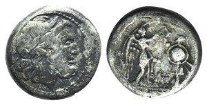 obverse: C/M series, Sicilian mint, 211-208 BC. AR Victoriatus (16mm, 3.13g, 2h). Laureate head of Jupiter r.; C behind. R/ Victory standing r., erecting trophy; M between. Crawford 71/1a; RSC 36a. Good Fine