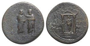 obverse: Augustus with Caius and Lucius Caesars (27 BC-AD 14). Mysia, Pergamum. Æ (21mm, 5.23g, 12h). Kephalion, grammateus, c. AD 1. Demos of Pergamum standing slightly l., crowning Demos of Sardis to l. R/ Distyle temple containing facing statue of Augustus. RPC I 2362. Good Fine
