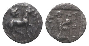 obverse: Thessaly, Larissa, c. 460-400 BC. AR Obol (9mm, 0.58g, 3h). Horse trotting r.; above, head of lion r. R/ Larissa standing r., balancing hydria on raised knee; to l., spouting water fountain r. in the form of lion's head; all within incuse square. BCD Thessaly II 358.1; HGC 4, 482. VF