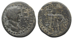 obverse: Trajan (98-117). Judaea, Ascalon. Æ (19mm, 6.30g, 12h). Laureate head r. R/ War-god Phanebal standing l., holding harpa (?) in r. hand and small round shield and long palm branch in l. hand. RPC III 3979. Green patina, Good Fine