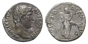 obverse: Hadrian (117-138). AR Denarius (16mm, 3.40g, 6h). Rome, 134-8. Bare head r. R/ Victory advancing r., pulling out dress and holding branch. RIC II 282; RSC 1454. Toned, VF