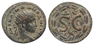 obverse: Elagabalus (218-222). Seleucis and Pieria, Antioch. Æ (21mm, 4.15g, 6h). Radiate head r. R/ S • C, Δ Є above, eagle below; all within laurel wreath fastened at top with star. McAlee 788c. VF