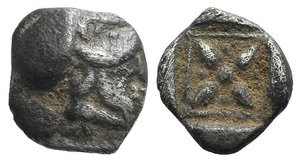 obverse: Asia Minor, Uncertain mint, 5th century BC. AR Hemiobol (7mm, 0.34g). Helmeted head of Athena r. R/ Star of four rays; pellets between rays; all within beaded square border within incuse square. Unpublished in the standard references, but cf. CNG 287, lot 217. Near VF