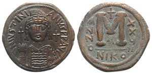 obverse: Justinian I (527-565). Æ 40 Nummi (34mm, 18.34g, 6h). Nicomedia, year 27 (543/4). Helmeted and cuirassed facing bust, holding globus cruciger and shield; cross to r. R/ Large M; cross above, date across field; A//NIKO. MIBE 113a; DOC 122a; Sear 201. Brown patina, Good VF