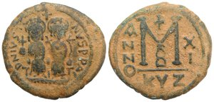 obverse: Justin II and Sophia (565-578). Æ 40 Nummi (31mm, 12.86g, 12h). Cyzicus, year 11 (575/6). Justin, holding globus cruciger, and Sophia, holding cruciform sceptre, seated facing on double throne; cross above. R/ Large M; cross above, date across field; B//KYZ. MIBE 50d; DOC 101e; Sear 372. Brown patina, VF