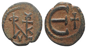 obverse: Justin II (565-578). Æ 5 Nummi (14mm, 1.64g, 6h). Theoupolis (Antioch). Monogram. R/ Large Є; cross to r. MIBE 65a; DOC 186; Sear 386. Brown patina, Good VF