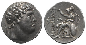obverse: Kings of Pergamon, Eumenes I (263-241 BC). AR Tetradrachm (30mm, 17.02g, 12h). In the name of Philetairos. Pergamon, c. 255/0-241 BC. Laureate head of Philetairos r. R/ Athena enthroned l., elbow resting on shield to r., crowning dynastic name; transverse spear in background, grape bunch to outer l., monogram to inner l., bow to r. Westermark Group V; SNG BnF 1618. Toned, light scratch on rev., VF - Good VF