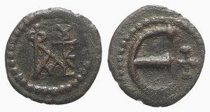 obverse: Justin II (565-578). Æ 5 Nummi (14mm, 1.68g, 7h). Theoupolis (Antioch). Monogram. R/ Large Є; cross to r. MIBE 65a; DOC 186; Sear 386. Green-brown patina, VF - Good VF