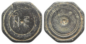 obverse: Byzantine Æ Octagonal Coin Weight - 5 Nomismata, c. 6th-7th century (28mm, 19.67g). Ṅ E inlaid in silver within double incuse circle. R/ Triple incuse circle. Rare, green patina, VF