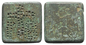 obverse: Byzantine Æ Ounce Square Commercial Weight, 5th-7th centuries AD (22mm, 24.55g). Punch-engraved cross with Γ-B. R/ Blank. Green patina, VF