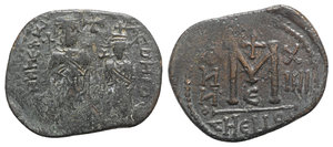 D/ Islamic, Arab-Byzantine Æ 40 Nummi (30mm, 9.01g, 6h). Imitating of Heraclius and Heraclius Constantine, Antioch, year 14 (AD 623/4). Heraclius and Heraclius Constantine standing facing, each holding cross, small cross above. R/ Large M between ANNO and X/IIII; small cross above, Є below, THEUP in exergue. Cf. Roma Numismatics E-Sale 30, October 2016, lot 655, otherwise unpublished. Very Rare, VF