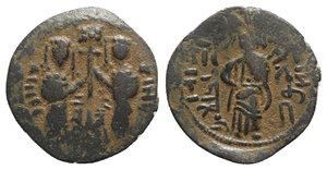 obverse: Islamic, Anatolia & al-Jazira (Post-Seljuk). Zangids, Nur al-Din Mahmud (AH 541-569 / AD 1146-1173). Æ Dirham (24mm, 3.17g, 6h). Unnamed (Halab). Two Byzantine-style imperial figures standing facing, holding between them labarum set on three steps. R/ Christ standing facing. S&S Type 73; Album 1850. Brown patina, VF