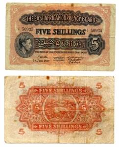 D/ AFRICA ORIENTALE. 5 Shillings. 1939. BB+. Macchioline, notevole riga centrale.