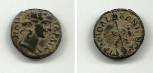 obverse: Periodo di TRAIANO. Lydia, Sardeis. AE 15 (1,78 gr.). Testa di Dioniso a destra. R.\: Tyrosos adornato. BB. NC.