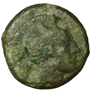 obverse: LUCANIA, Thourioi. 340 BC. Bronze. 5.35 gr. – 16.7 mm. O:\ Head of Athena right, in crested helmet decorated with Skylla holding a trident. R:\ ΘOYΡIΩN, bull butting left. BMC 129 var. VF+