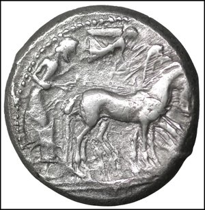 reverse: Sicily, Syracuse AR Tetradrachm. Deinomenid Tyranny. Time of Hieron I, circa 480/78-475 BC. 17.21 gr. – 24 mm, 2h.  O:\ Charioteer, holding kentron and reins, driving walking quadriga right; above, Nike flying to right, crowning horses. R:\ Head of Arethusa right, wearing earring, necklace and headband, her hair tied in a krobylos; ΣVRΑKΟΣΙΟΝ and four dolphins around. Boehringer 149 (V66/R103); SNG ANS 42; Randazzo 316 (same dies). Attractive light tone. XF