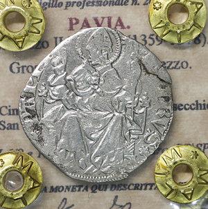 D/ PAVIA. Galeazzo II Visconti (1359-1378). Grosso da un soldo e mezzo. 2.26 gr. – 24.0 mm. D:\ Cimiero con drago tra tizzoni e secchie. R:\ San Siro in trono con pastorale CNI 6/9 e 13/14; MIR 845/1. Raro. BB\SPL