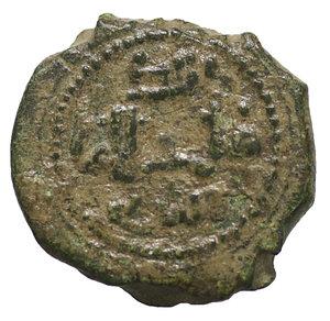D/ Regno di Sicilia. Messina. Guglielmo II (1166-1189). Follaro. 1,90 gr. - 14.2 mm. O:\ Testa di leone. R:\ Iscrizione cufica. Spahr 118; MIR 37. SPL