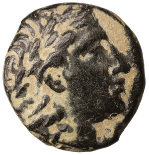 obverse: Seleucid. Seleukos II Kallinikos. 246-226 B.C. Bronze unit. 4.40 gr. - 16.5 mm. Mint of Sardes. O:\ Head of Hercules right wearing lion-skin headdress, paws tied at neck R:\ ΒΑΣΙΛΕΩΣ / ΣΕΛΕΥΚΟΥ, legend vertically downward to right and left of naked Apollo Delphios seated left on omphalos, holding arrow and grounded bow; monogram in outer left and Σ in outer right field. . SNG Spaer pl. 29, 443-4; HGC 9, 344.  Sandy patina. UNC