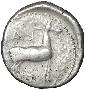 reverse: BRUTTIUM, Kaulonia. 480-380 BC. Nomos. 21,6 mm, 8.00 gr,. Apollo advancing right, holding branch; to right, stag standing right; ΚΑΥΛ. R:\ Stag standing right. KA. Noe,C. 38.99 (R: same). HN Italy 2046. SNG Cop. 1709. Winterthur 484. Rare. VF \XF