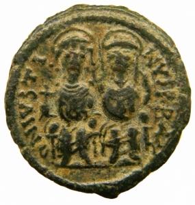 obverse: Bizantini. Giustino II. 565-578 d.C. Follis. AE. Nicomedia. D/ Giustino e Sofia seduti di fronte su doppio trono. R/ ANNO III. Grande M. Sotto B. In esergo: NIKO. D.O. 92. Peso 12,85 gr. Diametro 26,50 mm. BB+.=