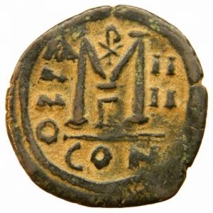 reverse: Bizantini. Tiberio II Costantino. 578-582 d.C. Follis. Æ. Nicomedia. D/ O m TIb CONS-TANT P P AVG, Busto frontale. R/ M ANNO e croce G III, in esergo CON . SEAR 428 Peso 14,35 gr. Diametro 27,43 mm. qBBBB+.=