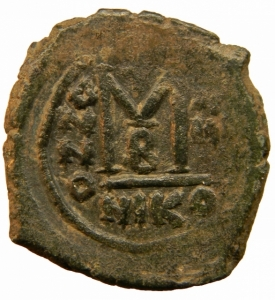 reverse: Bizantini. Maurizio Tiberio. 582-602 d.C. Follis. Æ. D/ Ô N MAUGI C N P AUT, Busto frontale. R/ M ANNO e B III. Peso 11,70 gr. Diametro 28,44 mm. BB+.=