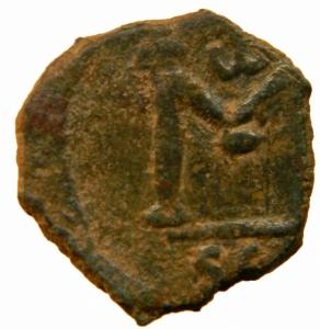 reverse: Bizantini .Costantino IV. 668-685 d.C. Follis. Siracusa. AE. D/ Busto elmato e corazzato di fronte, che tiene lancia e scudo. R/ Grande M. Sopra monogramma. Sear 35. In esergo: SCL. D.O.63. Sear 1210. Peso gr.6,30. Diametro 23,50 mm. .qSPL.=