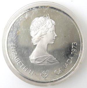 obverse: Monete Estere. Canada.Elisabetta II.10 Dollari 1973. Olimpiadi di Montreal 1976. Mappa del mondo. AG 925. Km. 86.1. Peso gr. 48,60. Diametro mm. 45.FDC.