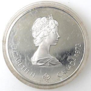 obverse: Monete Estere. Canada.Elisabetta II.10 Dollari 1973. Olimpiadi di Montreal 1976. Veduta di Montreal. AG 925. Km. 87. Peso gr. 48,6 0. FDC.